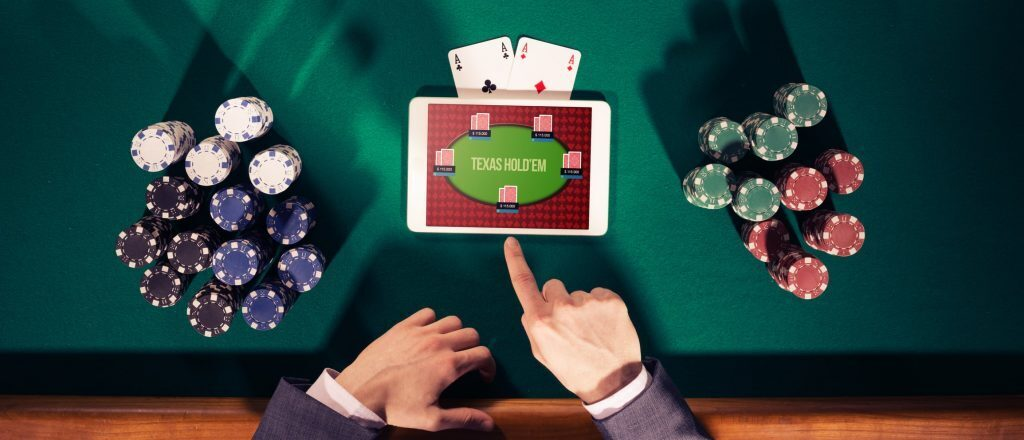 Tablet with casino app sitting on poker table.
