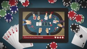 Tablet showing Texas Hold'em Poker sitting on a poker table with cards and chips.